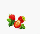Strawberries with leaves against a white background