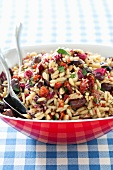 Orzo Salad with Olives and Sun Dried Tomatoes; In a Serving Bowl