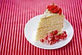 A slice of strawberry and redcurrant cake