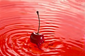 A red cherry in cherry juice