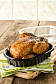 Rotisserie Chicken in Plastic Container with Lid Off