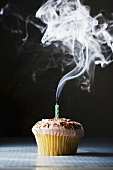 A cupcake with a blown-out candle
