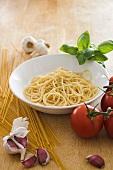 Spaghetti, tomatoes, garlic and basil