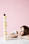 A woman looking at stack of cupcakes