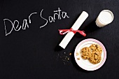 A note to Santa with milk and cookies
