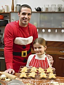 A father and daughter with gingerbread men