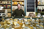 A portrait of a cheesemonger