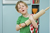 A boy with a rolling pin