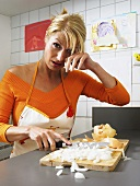 A woman chopping onions and crying