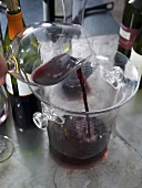 Red wine being poured into a container