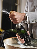 A champagne bottle being opened