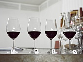 Glasses of red wine in a row