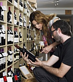 A couple in a wine shop