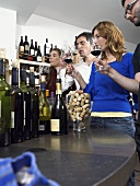 A group of friends at wine tasting session in a wine shop