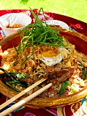 Nasi goreng with fried egg and spring onions