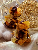 Cornflake clusters with chocolate
