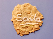 Almond biscuit with the word Santa