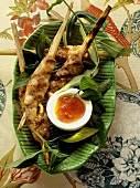 Pork and shrimp kebabs with spicy sauce