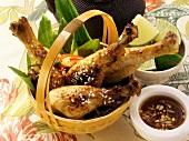 Asian chicken legs with sesame; limes; garlic sauce