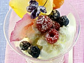Quark dessert with berries and candied flowers