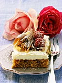 Nut cake with mascarpone, chocolate curls & raspberries