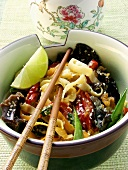 Asian noodles with vegetables and lime