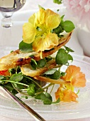 Watercress salad with flowers and toasted bread