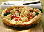 Vegetable quiche with tomatoes and cauliflower