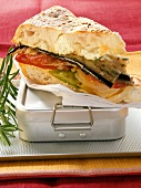 Sandwich with vegetables and cream cheese on lunch box