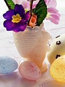 Pastel-coloured Easter eggs and spring flowers