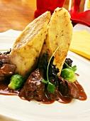 Venison ragout, dumplings, black chanterelles, Brussels sprouts
