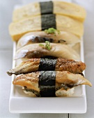 Nigiri sushi with mackerel, eel and egg custard