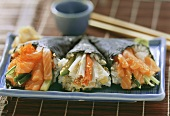 Temaki sushi with salmon and crabmeat