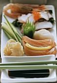 Sashimi with salmon, ginger and soy sauce