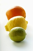 Lime, lemon and orange, one behind the other
