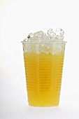 Orange juice in plastic tumbler with crushed ice