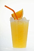 Orange juice with crushed ice, wedge of orange and straw