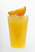 Orange juice with crushed ice and wedge of orange