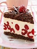 A piece of chocolate raspberry gateau with chocolate curls