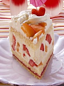 A piece of summery fruit gateau with cream