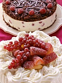 Chocolate raspberry gateau and cream cake with berries