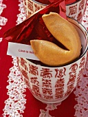 Fortune cookie on Chinese cup