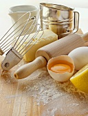 Various baking utensils, eggs, butter and lemon