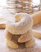 Vanilla crescents with baking utensils on chopping board