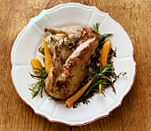 Roast legs of wild duck with herbs and carrots