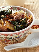 Duck with chard, sesame and rice; mixed spices