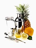 Various bar utensils and fruit