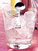 Ice cubes in glass with spoon (for cocktails)