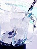 Ice cubes in blender with spoon