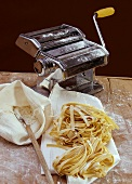 Home-made tagliatelle, flour and pasta maker